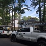 Eltz trucks and roofers by house